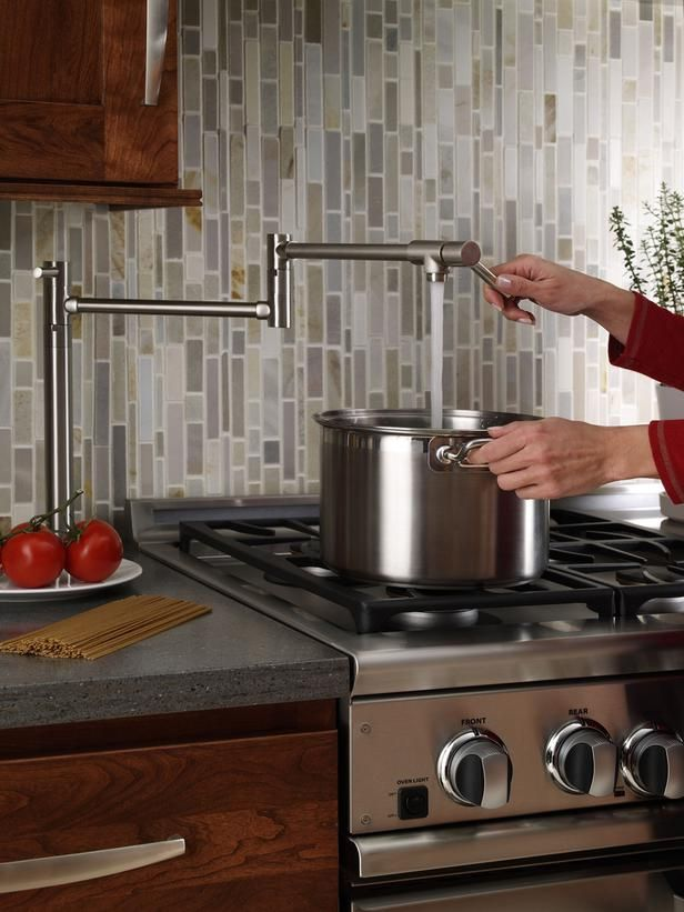 kitchen pot filler free standing sink unit sale this image was originally shared to highlight the convenience of but we happen love that vertical cascading tile backsplash