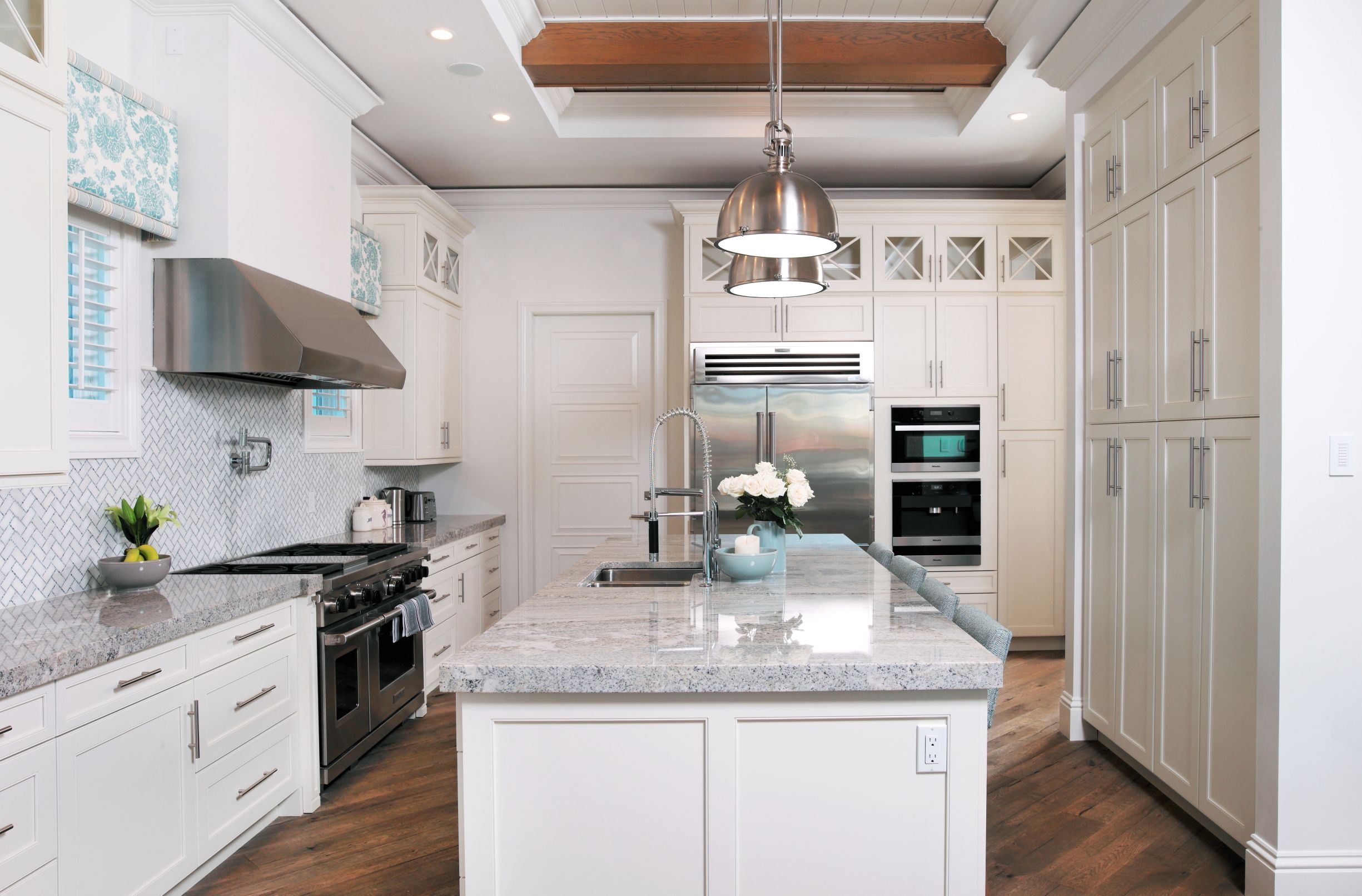 Large galley kitchen. Stainless steel appliances. Granite countertop and island. Home custom designed by Don Stevenson Design located in Naples, Florida. www.donstevensondesign.com