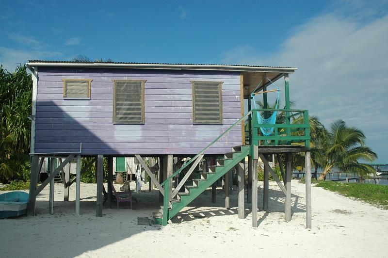 Purple beach house on stilts things i like pinterest for Small beach house on stilts