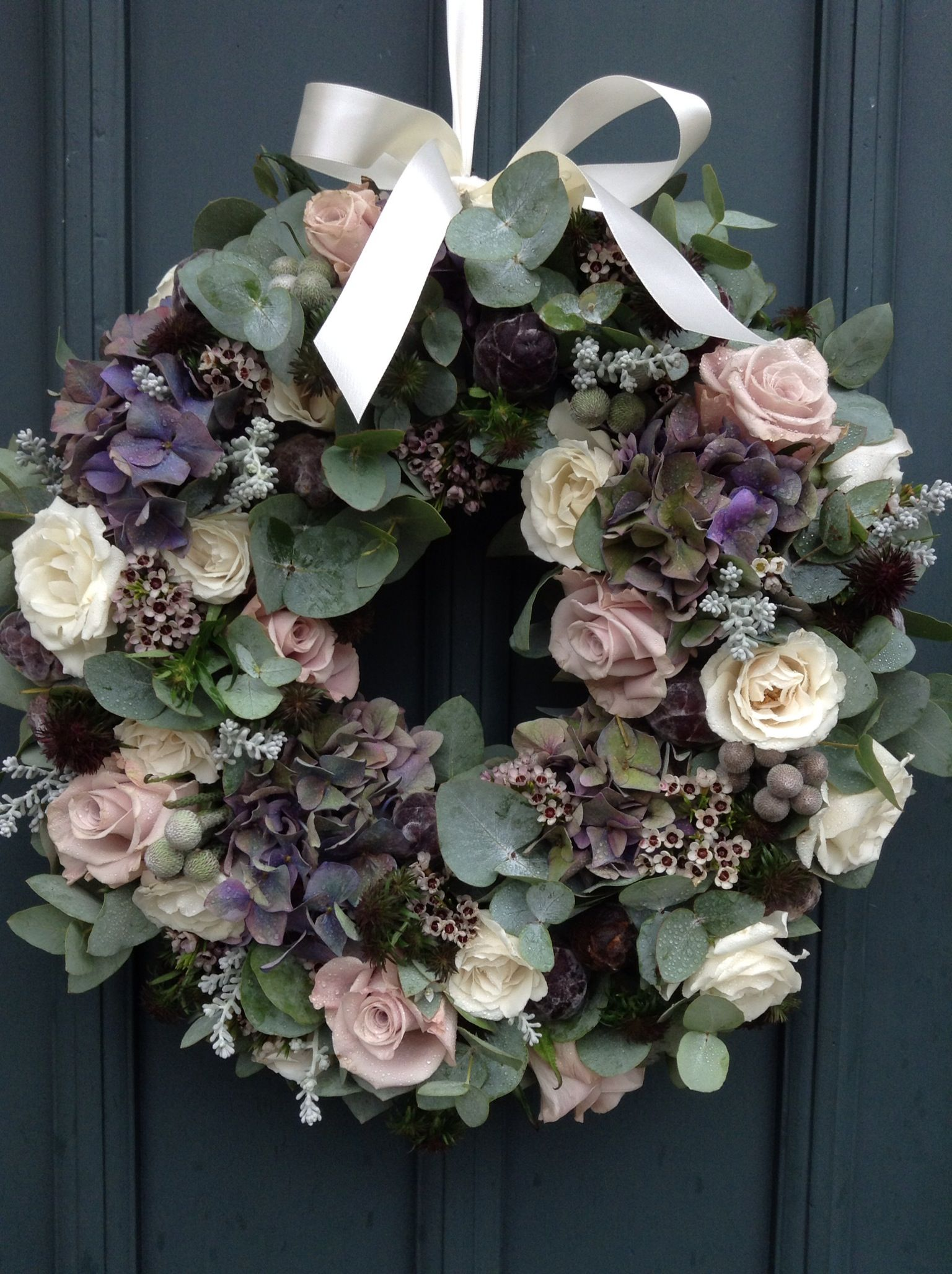 Director Rachel recently styled her friend Lucie's wedding - this door wreath is one of our favourites.