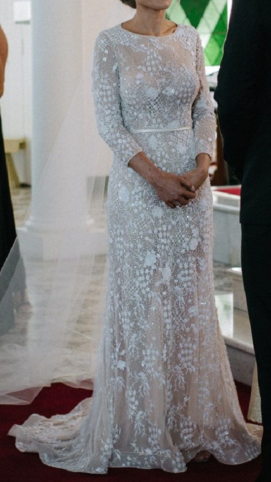 An elegant long sleeve wedding dress with nude underlay to accentuate the lace