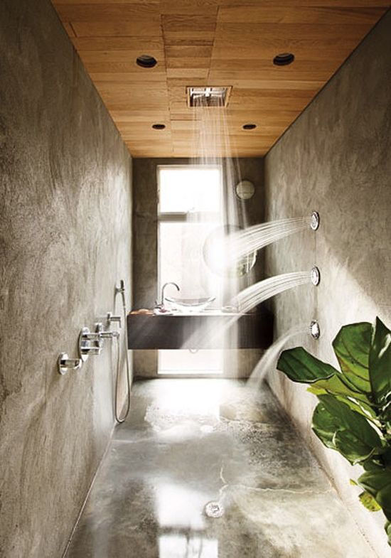 Stucco Shower With Numerous Showerheads And Wooden Ceiling Designed By Hank Mitchell