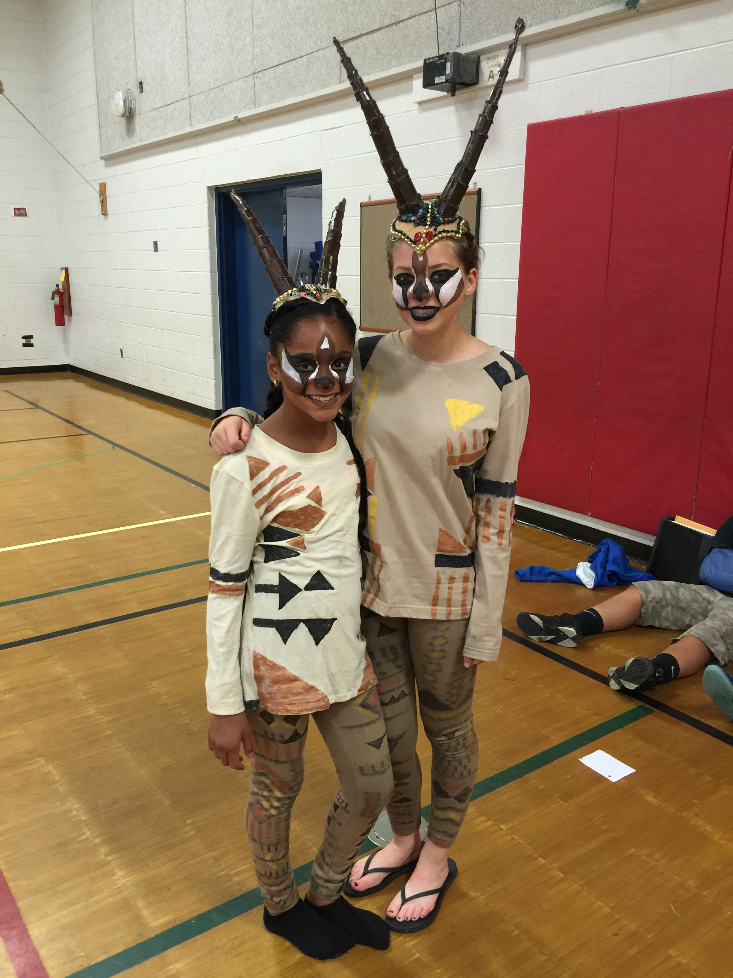 artist/mom painted tops and one-size-fits-all lined leggings we found online for cheap price. Kids on costume crew made the head pieces which were very elaborate and a big hit