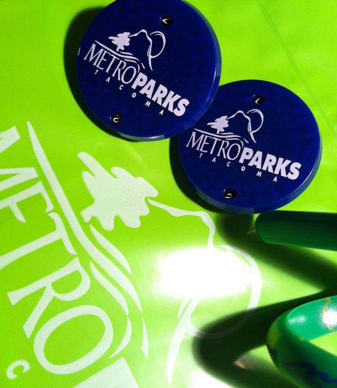 Biodegradable plastic bags and toys for Metro Parks... decoder ring and stress toy.