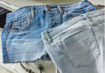 Upcycle your old jeans into BoHo stamped shorts! DIY Stamped Denim Cutoff Shorts #plaidcrafts #fabriccreations