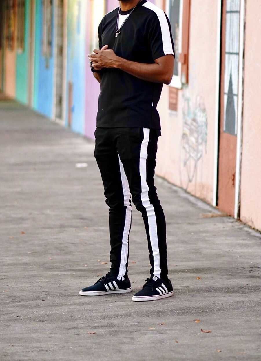 8d753bd2a62 Black and White Outfit featuring our Stripe Track T-shirt and our Double Striped  Track Pants available online!