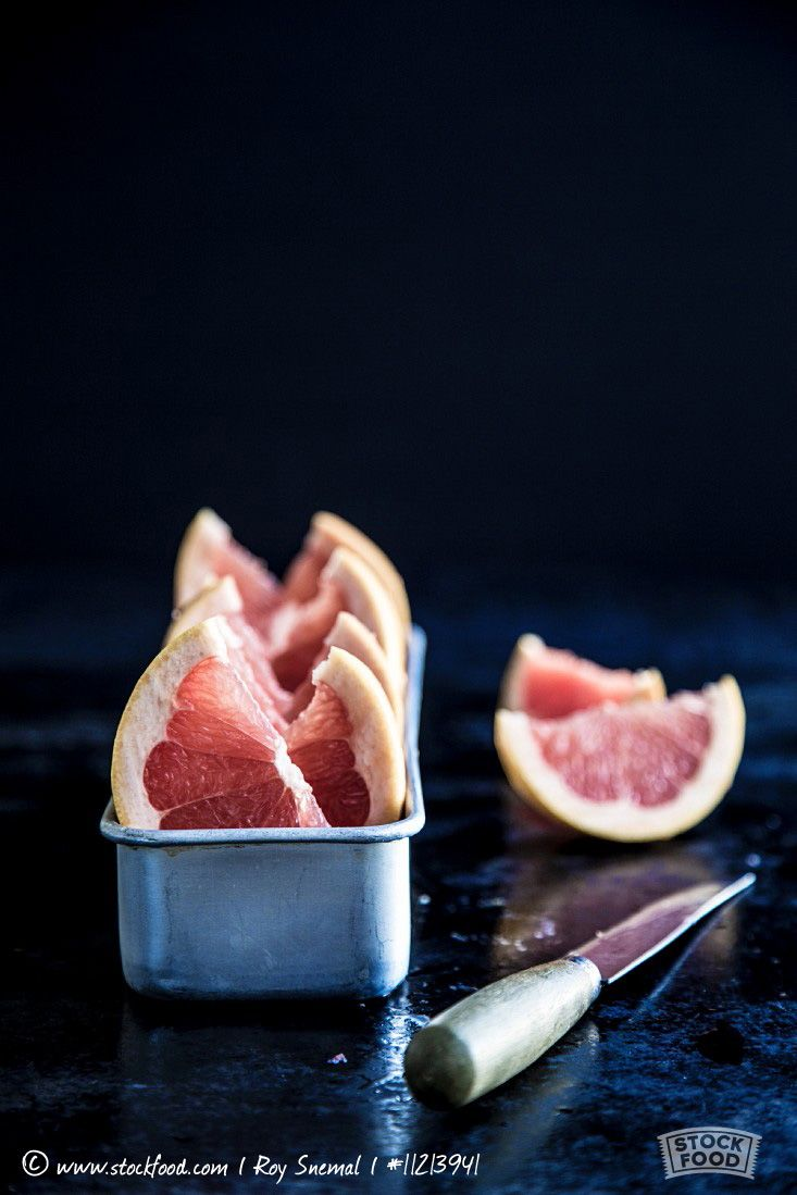Grapefruit wedges in a metal container