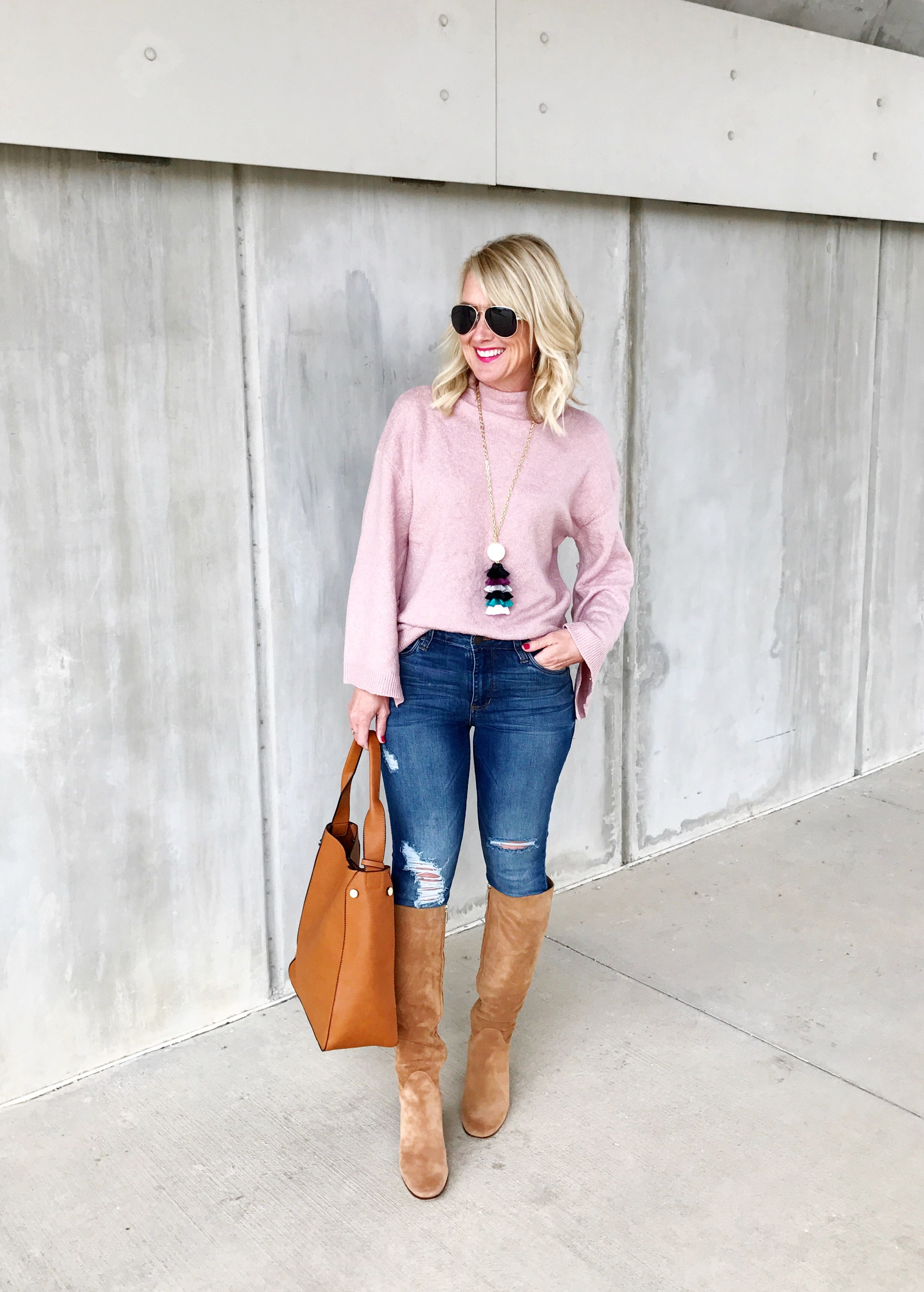 d125291612e19 Pink sweater with blue jeans and tall warm caramel boots