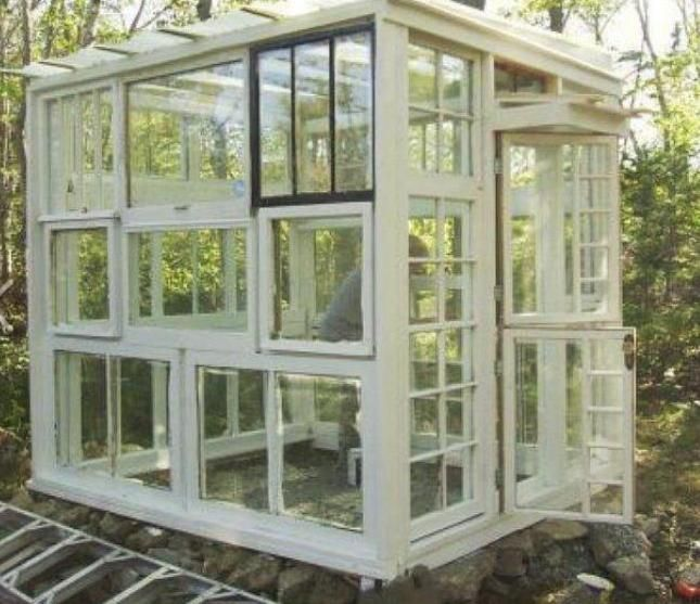 upcycled greenhouse from junkyard windows