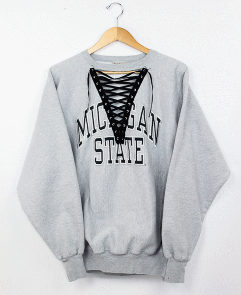 Michigan State Laceup College Sweatshirt - L ⎽⎽⎽⎽⎽⎽⎽⎽⎽⎽⎽⎽⎽⎽⎽⎽⎽⎽⎽⎽⎽⎽⎽⎽⎽⎽⎽⎽ ◊ One of a kind lace-up reworked sweatshirts ◊ ⟫ Handpicked and carefully tailored in our Chicago studio. ⟫ Items may show typ