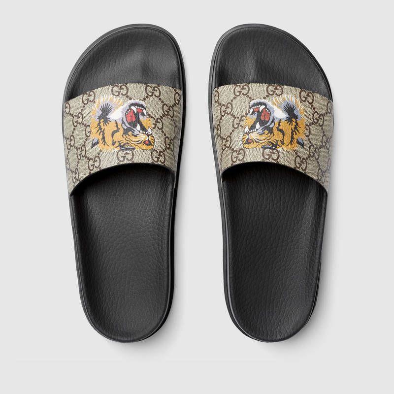 747725f69f7b Gucci GG Supreme tiger slide sandal Detail 3