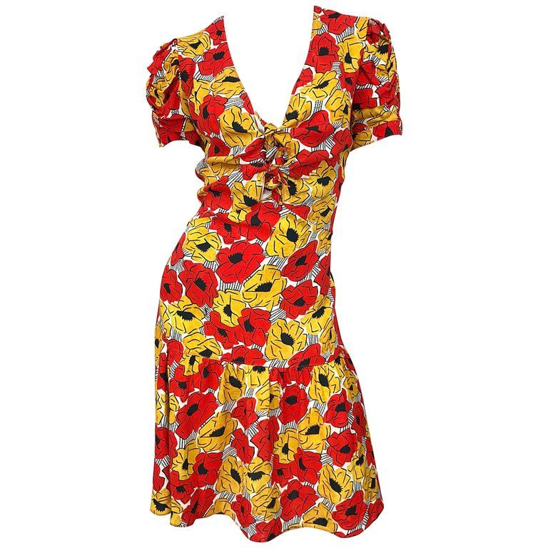 473af632 For Sale on 1stdibs - Beautiful YVES SAINT LAURENT red, yellow, black and  white poppy print drop waist cut-out dress! Features vibrant colors of red  and ...