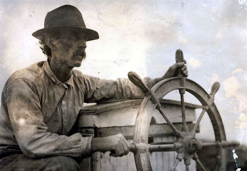 February 1911, Bayou La Batre, Alabama. The Skipper on the Oyster Barge, Mobile Bay. - Identified as Raymond Barbour Sr. (1870-1954) on the boat Wyandotte - Lewis Wickes Hine LC-DIG-nclc-04680 http://www.loc.gov #American #History #Alabama