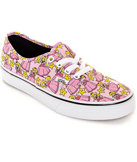 Rescue the princess in style with the Vans x Nintendo collaboration Princess Peach Authentics. The classic Authentic silhouette is transformed with a Princess Peach and golden star allover pattern and is accented by contrasting shoelaces with a Nintendo N