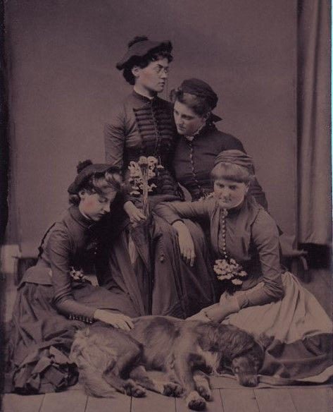 Victorian Mourning Photography. Four Ladies are mourning over their dead Dog.