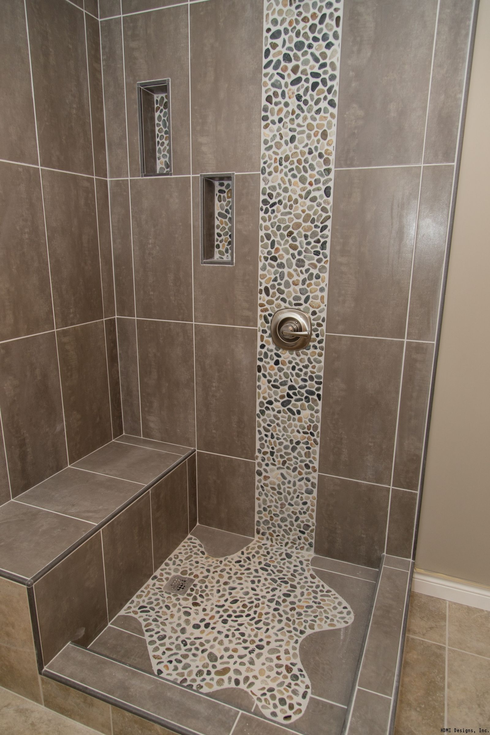 Spruce up your shower by adding pebble tile accents click for Bathroom tile designs photos