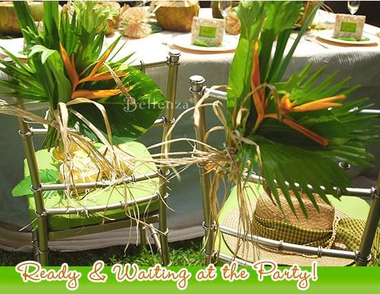 Tropical leaf chair decor for a safari-themed party (see ...