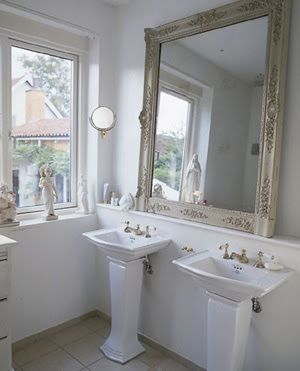 Love the smaller scale pedestal sinks with the over sized mirror! Beautiful