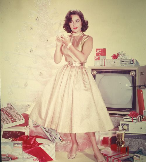 Elizabeth Taylor - Christmas  And to think, they thought Lindsay Lohan could come anywhere CLOSE to being this classy!