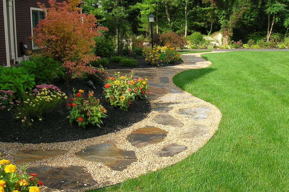 Gravel walkway with flagstone inlay front yard and back for Large front garden ideas
