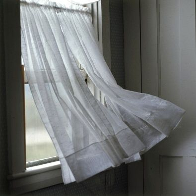 Wind blowing a curtain on a window royalty free images for White curtains wind