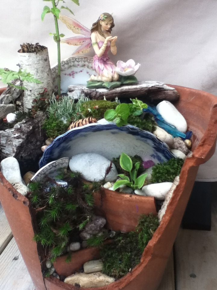 A Fairy Garden Using A Clay Pot And Broken Pottery Dishes