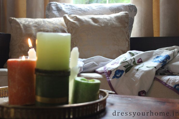 Bring in a sense of calm and warmth with candles, piled up cushions, and throws. #WinterStyling