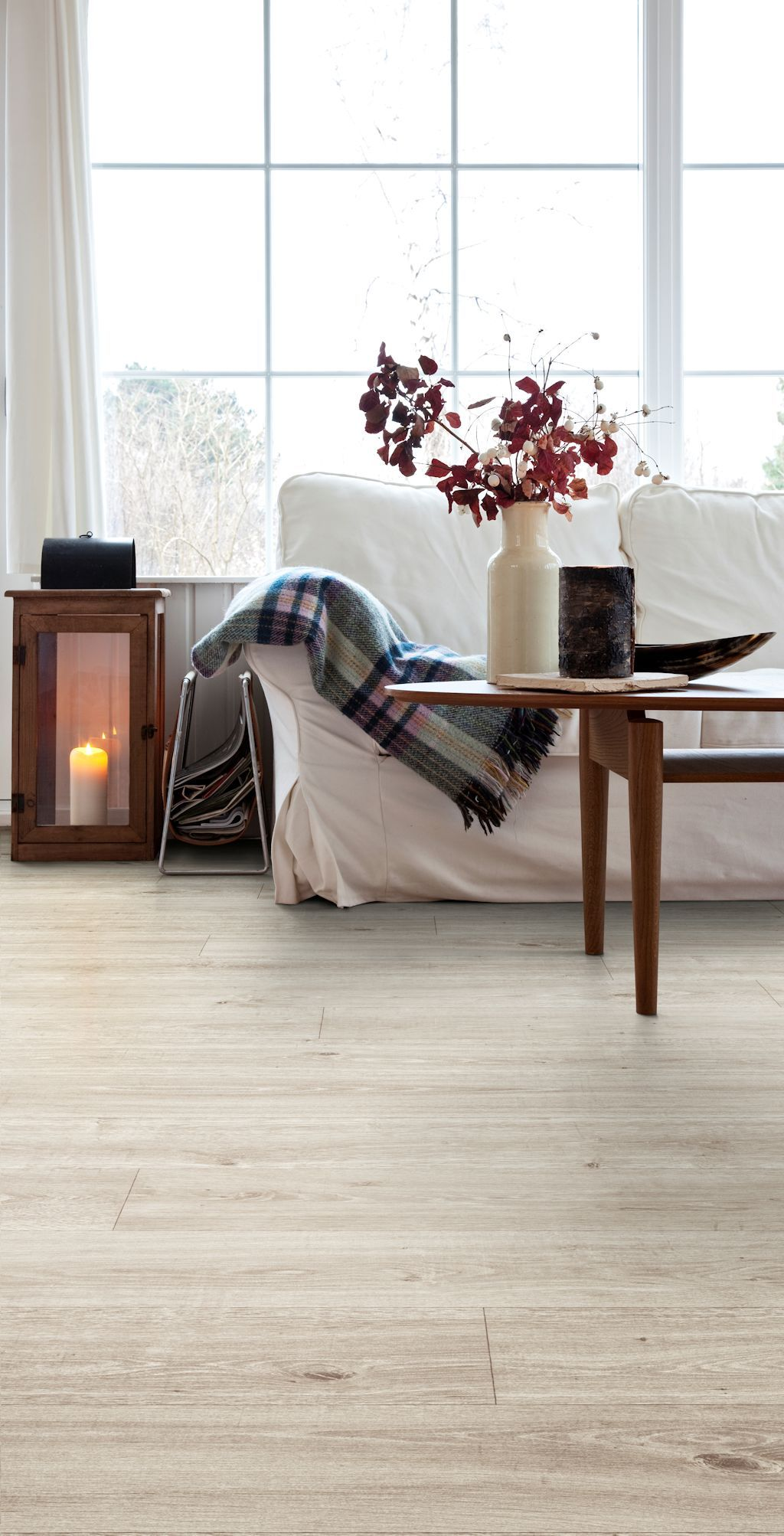 Living Room Featuring Secura Pur Luxury Vinyl Sheet Flooring In Coastal Oak