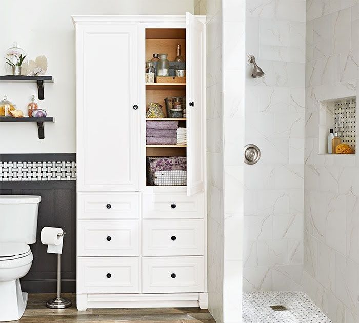 In lieu of a closet a tall armoire satisfies bathroom ...
