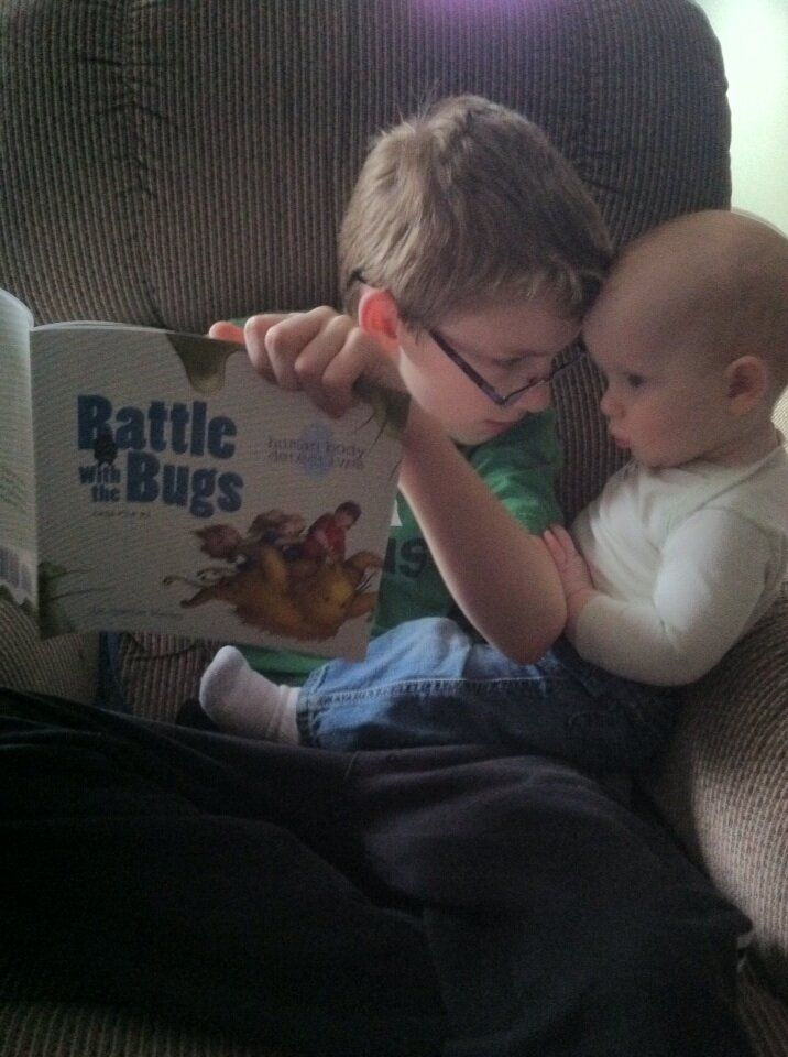 Child reading Battle with the Bugs @HBDetectives #homeschool #science #free