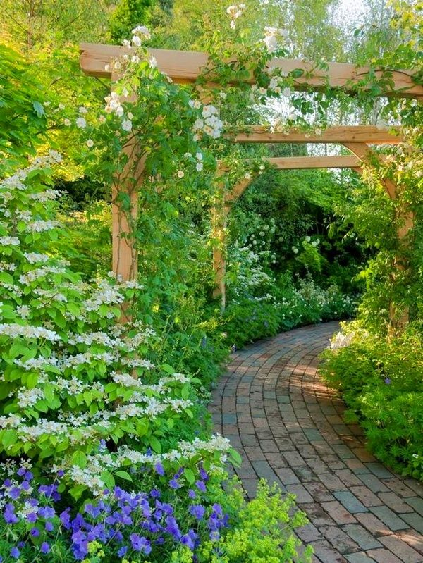 love these structures and how they draw you into the garden ...
