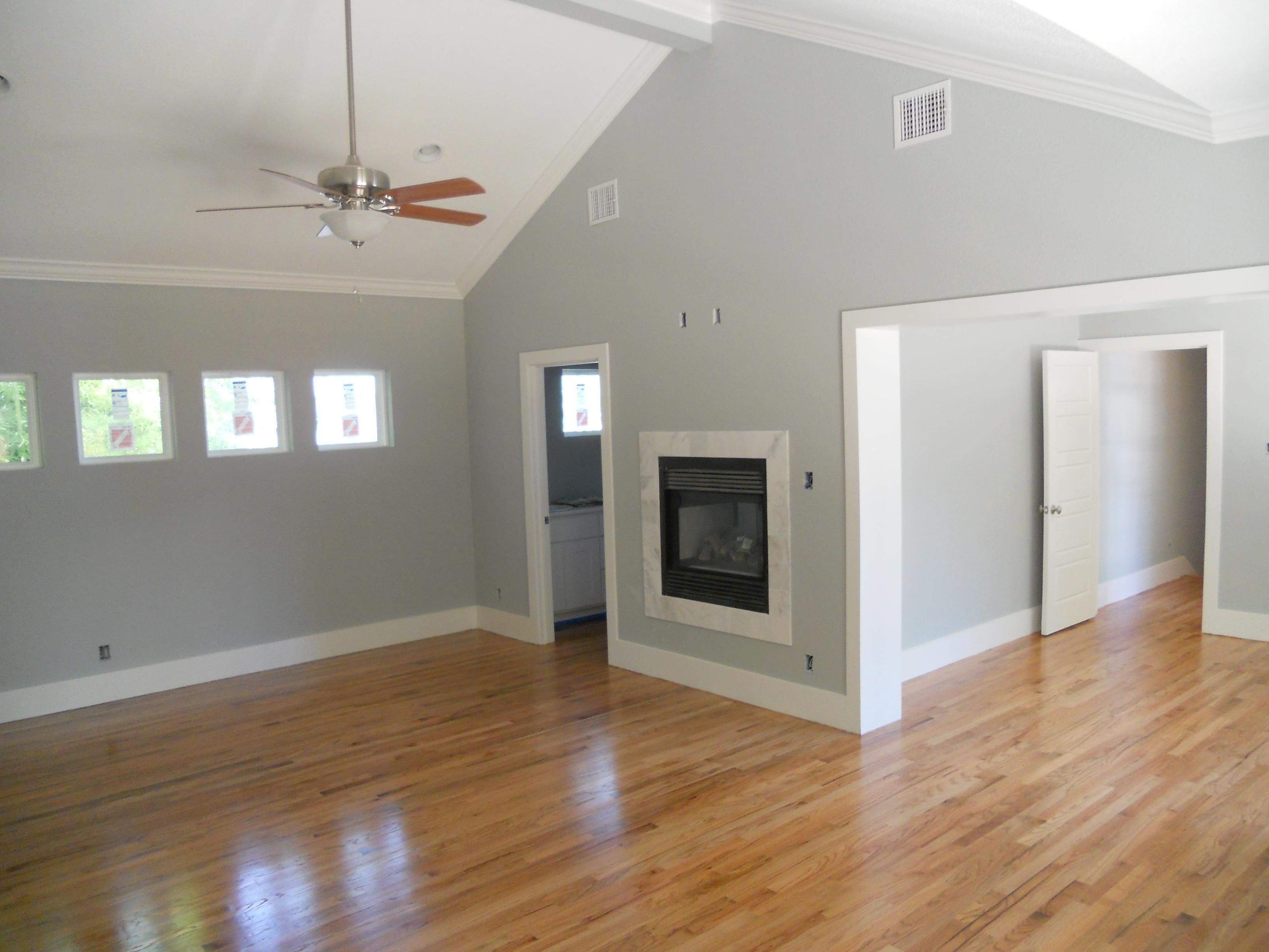 Dark Brown Wooden Color Laminate Flooring With Grey Walls In 2020 Living Room Wood Floor Oak Wood Floors Grey Walls