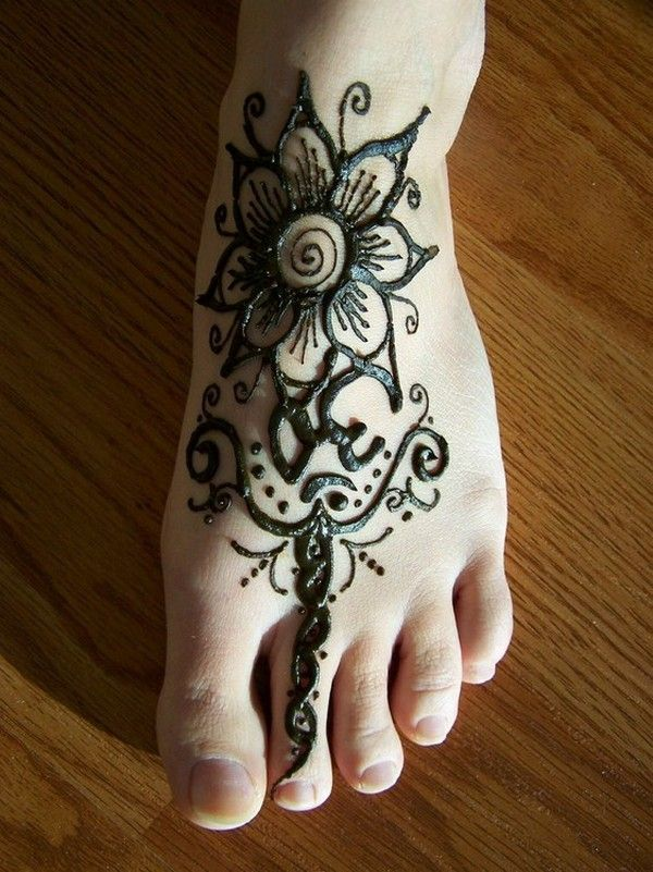 henna or pen. Simple design. I'd leave out the 'om', but I like how it takes up so much of the foot.