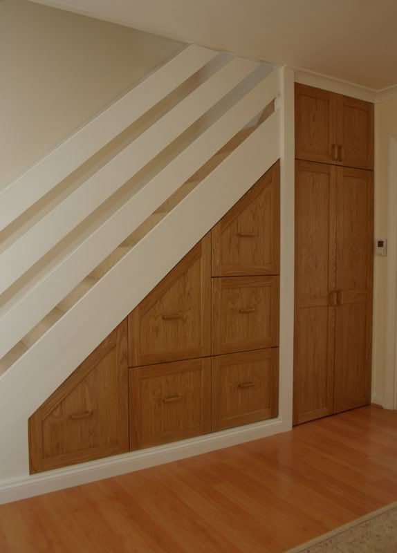 under stairs combo of drawers and closet design ideas
