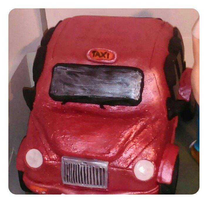 Red London taxi cab handmade of crisp rice marshmallow covered in sugarpaste