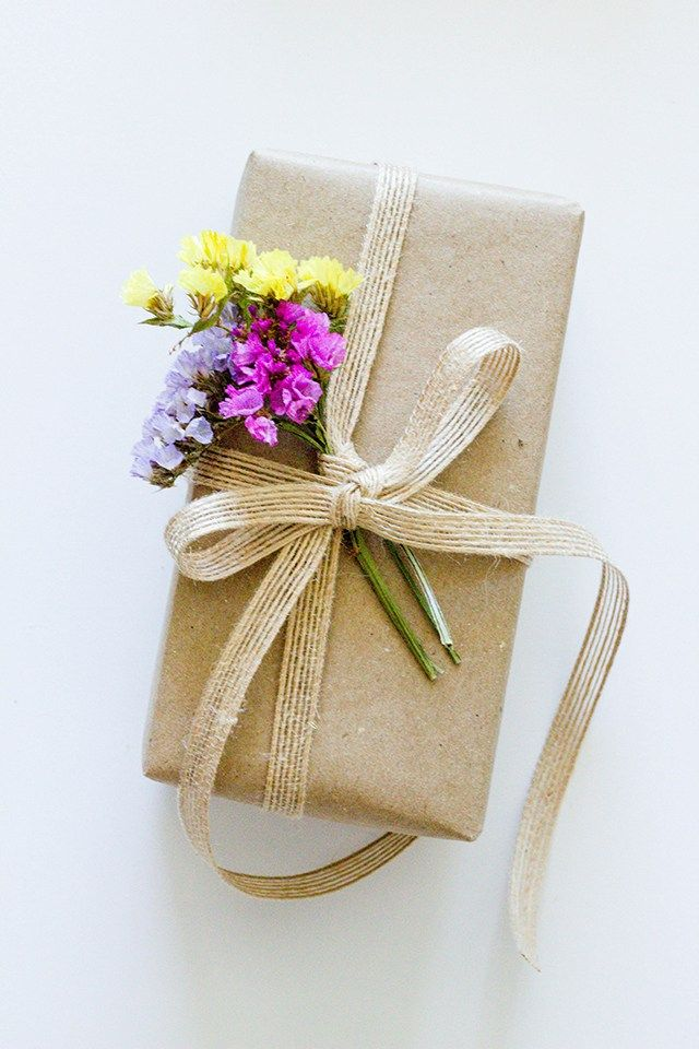 Spring flowers on brown paper packaging pinterest gifts gift spring flowers on brown paper creative gift wrapping present wrapping creative gifts wrapping mightylinksfo