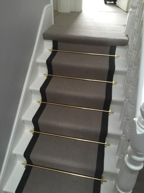 High Quality Grey Carpet With Black Border And Golden Stair Rods To Stairs