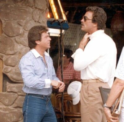 Larry Manetti and Tom Selleck behind the scenes of Magnum, P.I.
