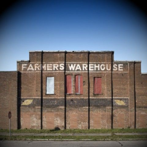 Farmer s Warehouse  one of the warehouses in Wilson used for selling  tobacco  Wilson. Farmer s Warehouse  one of the warehouses in Wilson used for