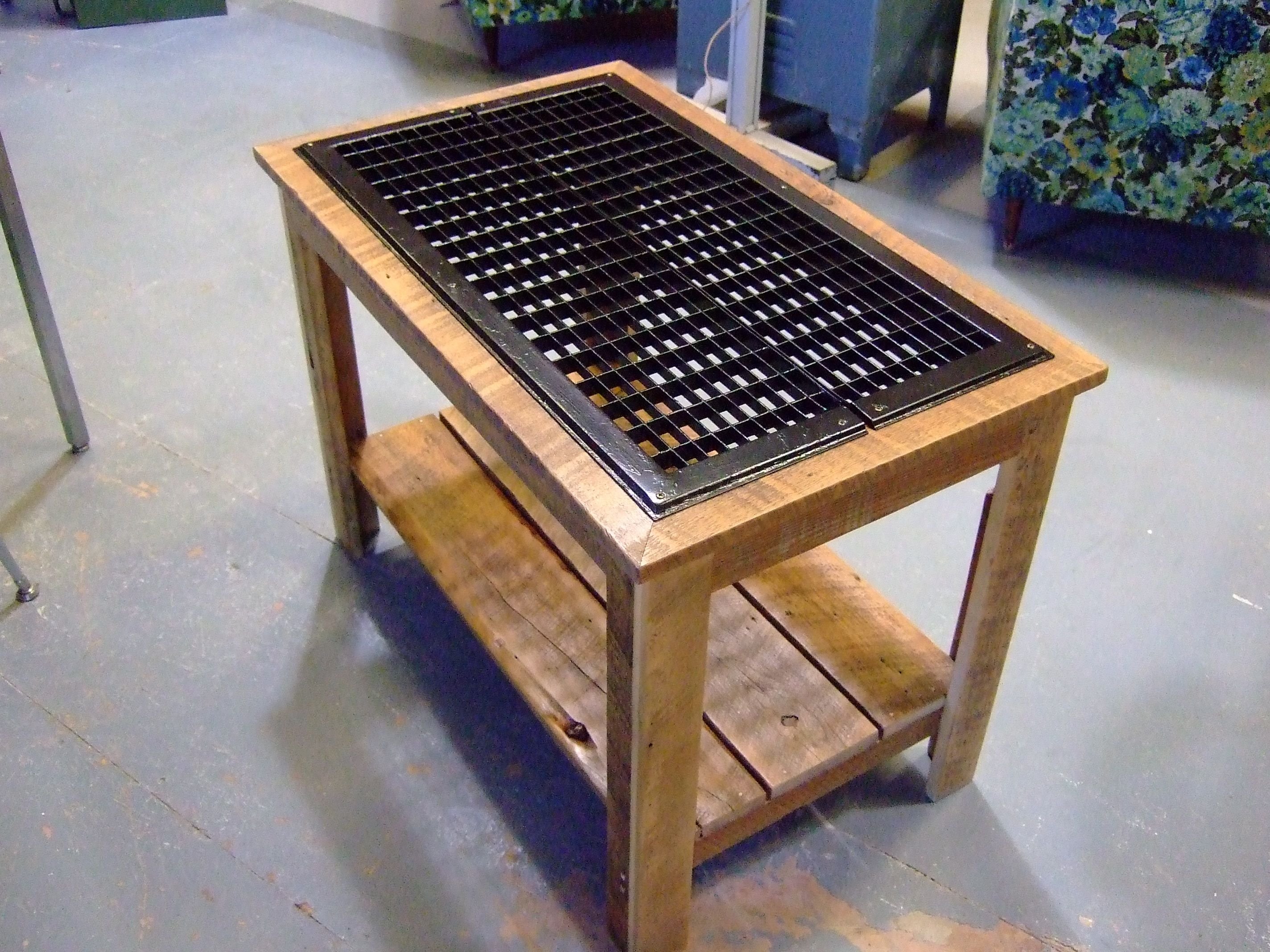 Grate table made from reclaimed steel floor grates and 4 year
