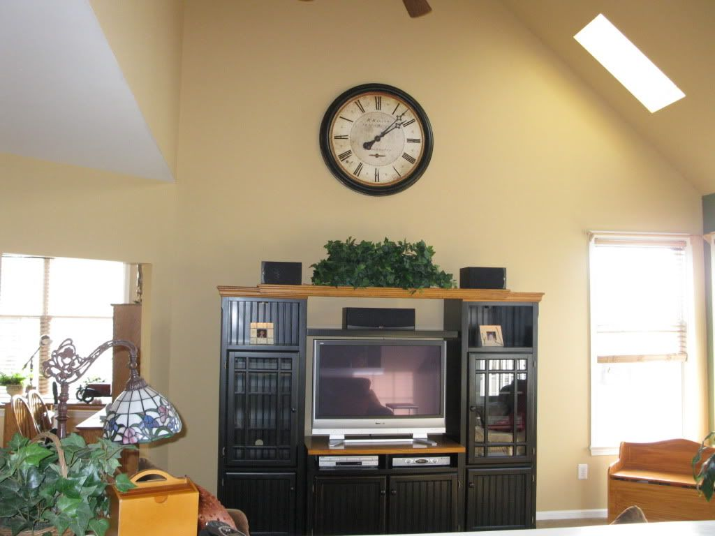 Decorating ideas for tops of entertainment centers with for How to paint a vaulted ceiling room