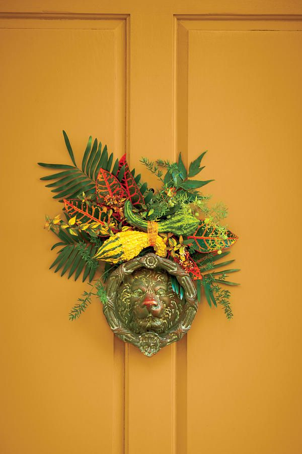 Fall Door Knocker Accent - Fabulous Fall Decorating Ideas - Southernliving. To accent the door knocker, zip-tie two crookneck gourds together, and then zip-tie them to a foam-core oval about 5 inches long. Cover ties with ribbon. Working at an angle, hot-glue sprigs of coontie palm, croton, holly fern, asparagus fern, and abelia to cover the foam core. Loop wire through one of the back ties, and hang above the door knocker. The hardy foliage will last about two weeks in cool weather and can…