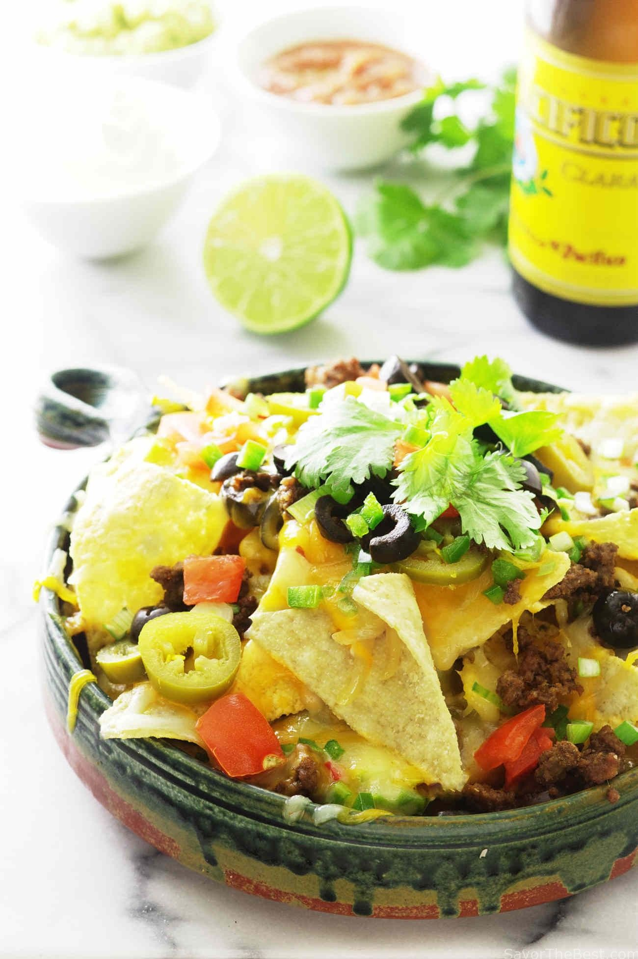 Serve up this plate of kamut chip spicy nachos with side dippers of guacamole, sour cream and salsa. These nachos are spicy, crunchy, cheesy and delicious.