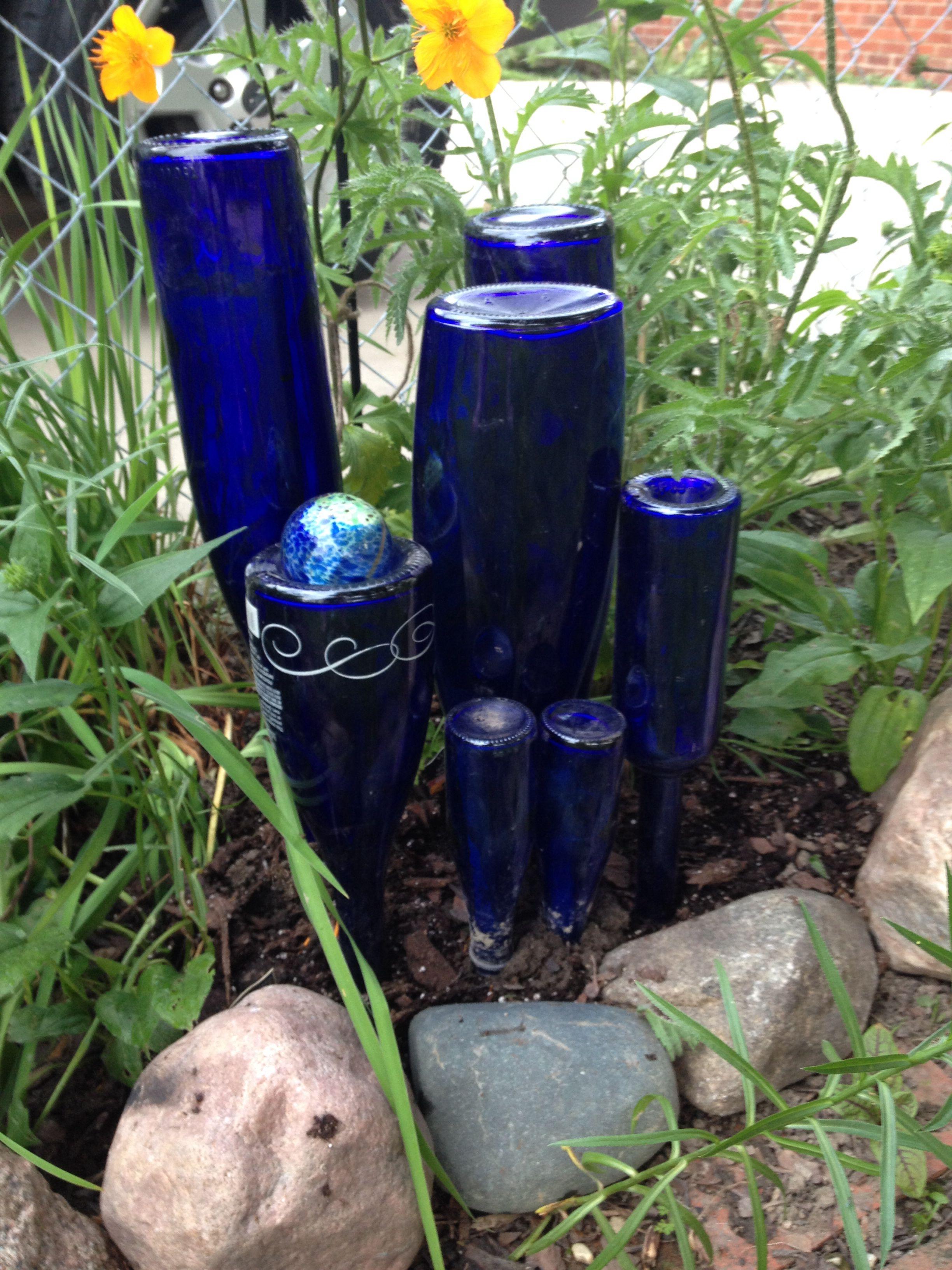 Blue bottle cluster in the garden | Upcycled Bottles | Pinterest ...