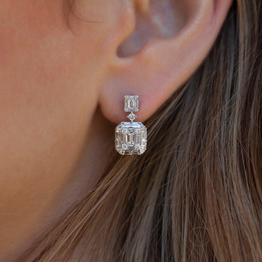 Photo of 14KT White Gold Baguette Diamond Kate Huggie Earrings