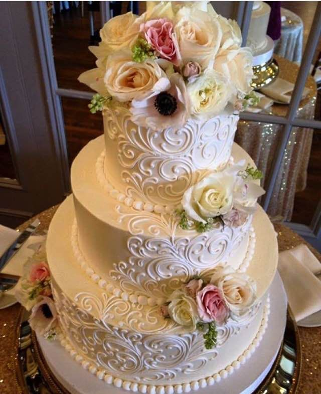 Classic Elegant Scrolling 3 Tier Buttercream Wedding Cake With Fresh Flowers