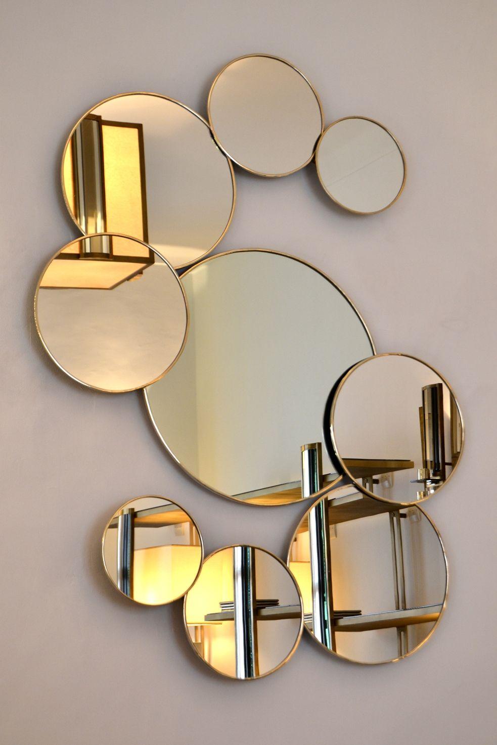 miroir ronds de la collection variance cerclage maillechort laiton ou acier tons disponibles noir gris argent bronze