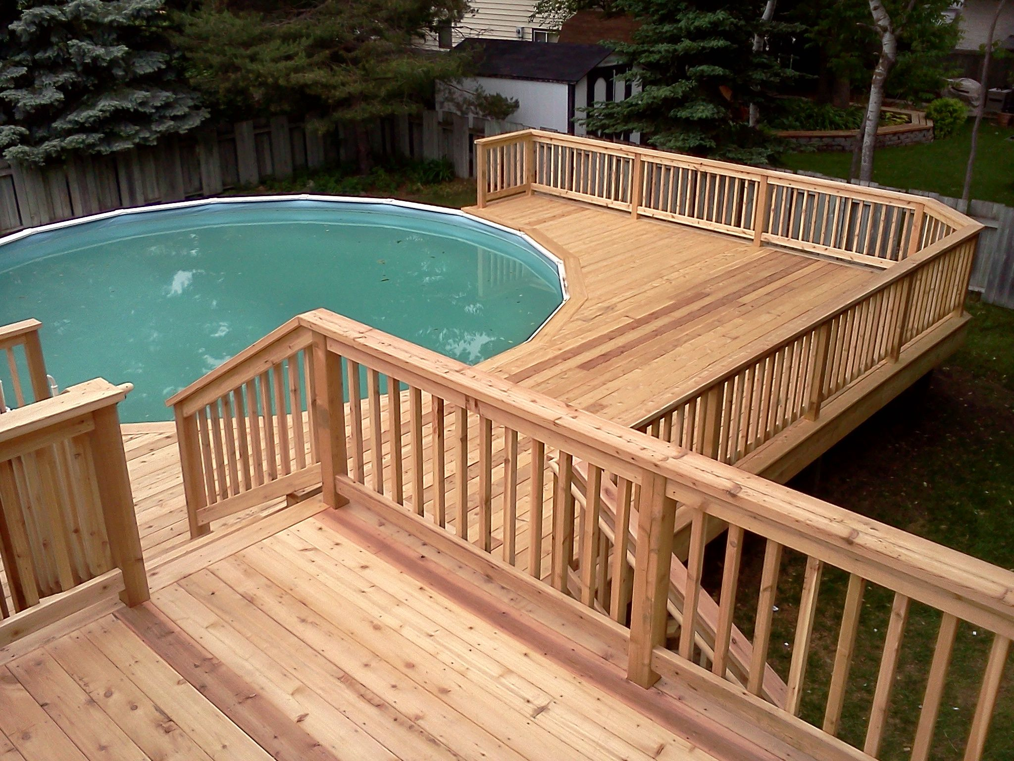 swimming pool simple wooden pool deck ideas for small and round shape swimming pool design scenic