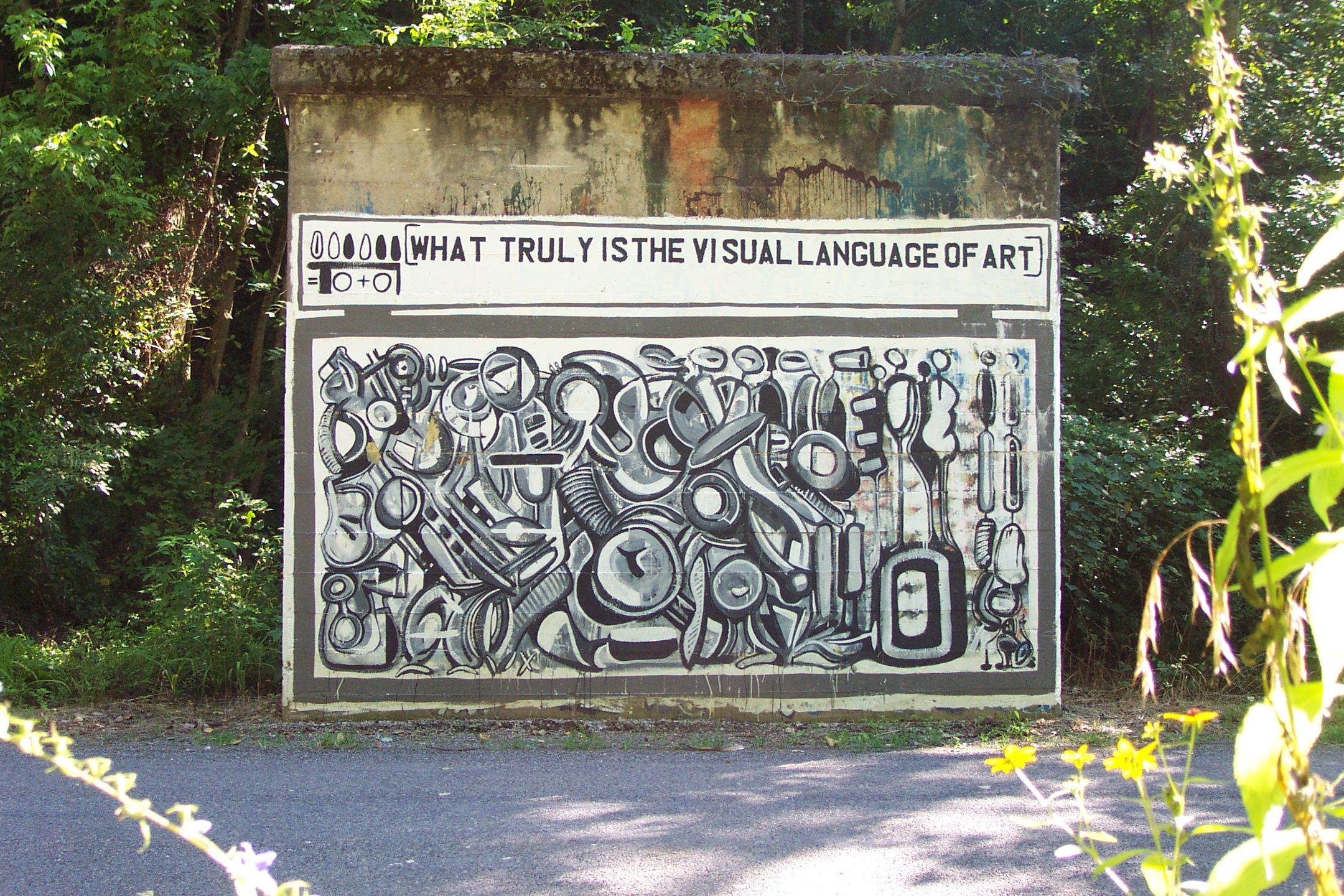 Art by John Agne on an old railroad trestle support in rural Columbia. Sadly, this work has deteriorated and suffered vandalism, but the photo lives on! Photo by Barbara Markham.