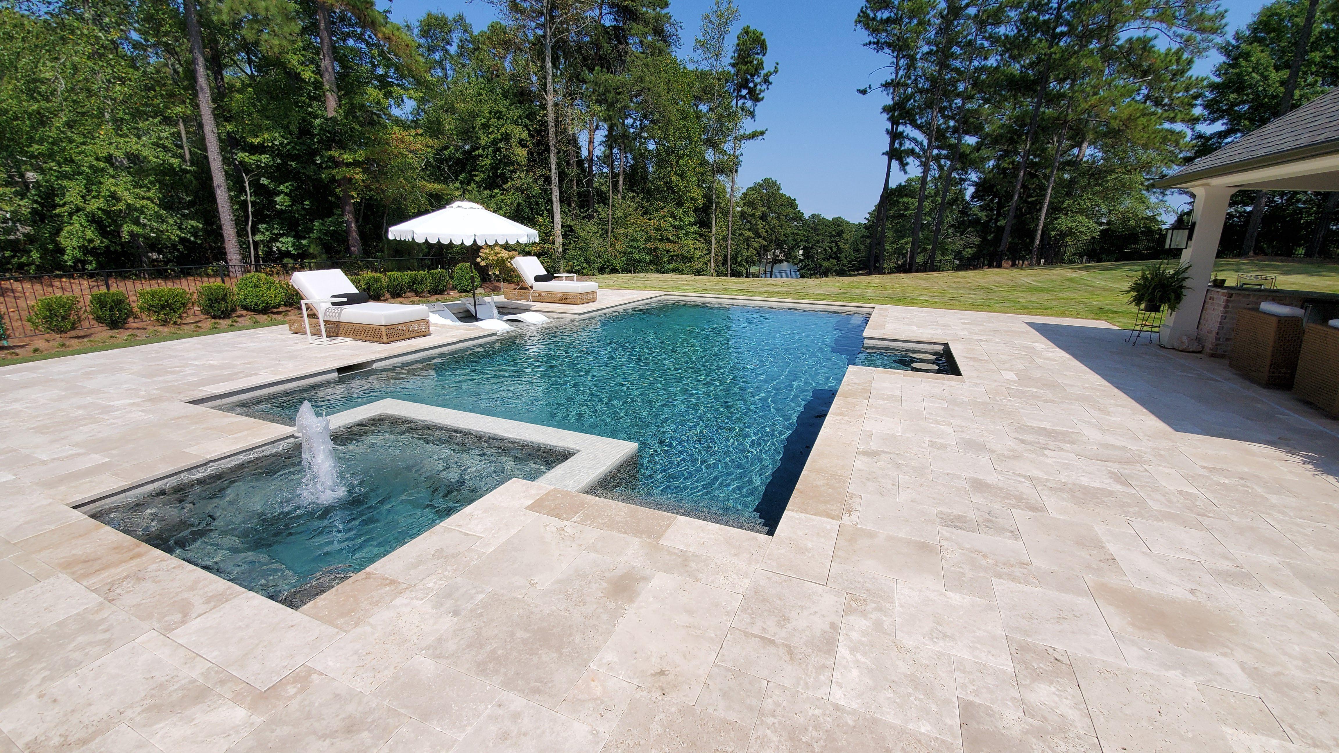 Inground Swimming Pool With Flush Spa Ivory Travertine Deck And Coping Swimming Pools Inground Swimming Pools Luxury Swimming Pools